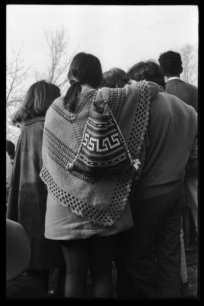 Crowd on Cambridge Common: woman in crocheted shawl, April 1968