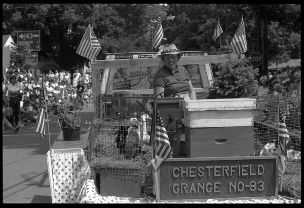 Chesterfield Grange float with beehives, a calf, and ducks at Chesterfield's Fourth of July parade, ca. July 4, 1991