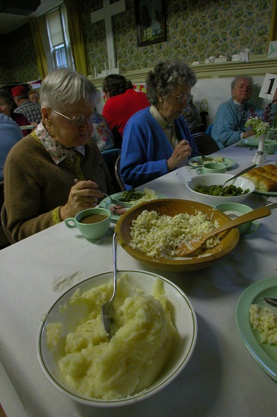 Church supper at the First Congregational Church, Whately: diners eating at their table, May 15, 2003