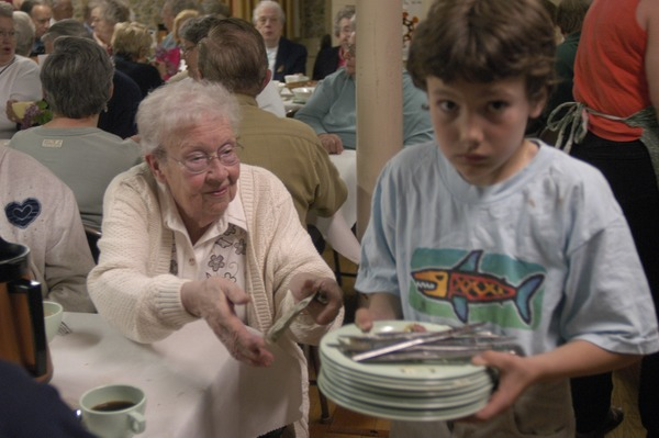 Church supper at the First Congregational Church, Whately: young boy busing             tables, May 15, 2003