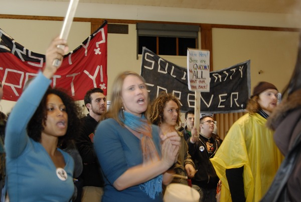 UMass student strike: strikers in the Student Union ballroom holding banners and         cheering, November 15, 2007