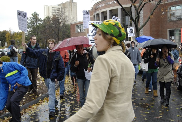 UMass student strike: strike organizer with a bullhorn, leading the march outside the Student Union building, November 15, 2007