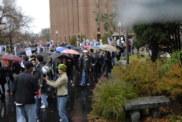 UMass student strike: strike organizer with a bullhorn, leading the march past             the Du Bois Library, November 15, 2007