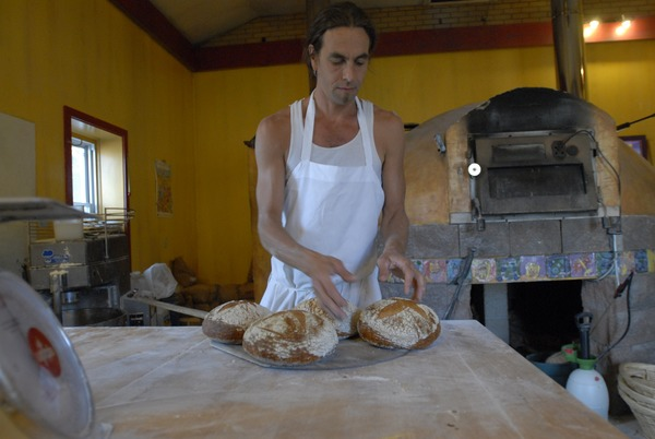 Hungry Ghost Bread: owner and baker Jonathan C. Stevens with fresh-baked bread, September 3, 2008