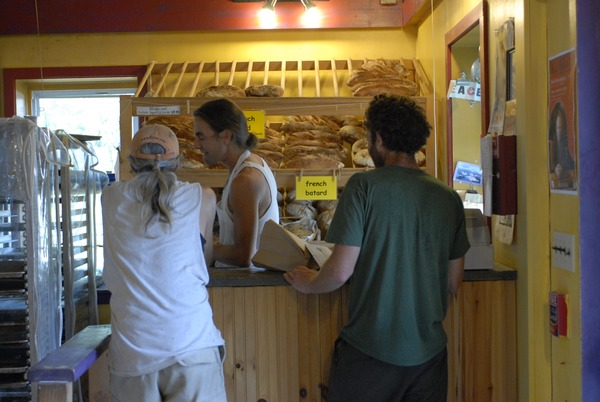 Hungry Ghost Bread: owner and baker Jonathan C. Stevens serving customers at the         counter, September 3, 2008