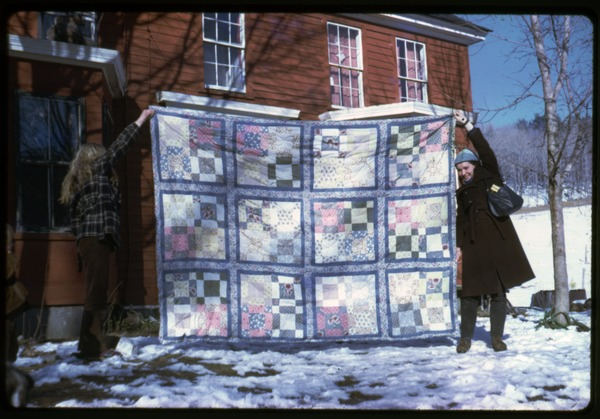 Janice Frey (left) and Isabel, holding up their quilt, Montague Farm commune, ca. 1975