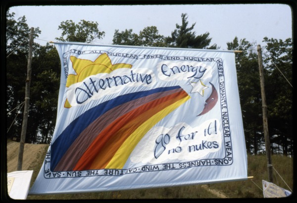 Antinuclear rainbow banner: 'Alternative energy, go for it! No nukes', ca. July 1988