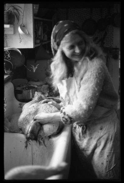 Janice Frey processing a turkey in the sink, Montague Farm Commune, ca. 1980
