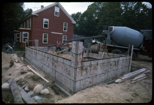 Pouring the foundation for an extension to the house, Montague Farm Commune, ca. September 1980