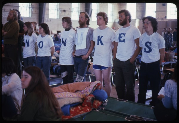 Affinity group: Occupation of the Seabrook Nuclear Power Plant: Occupiers standing in a row, wearing t-shirts spelling out No nukes: , ca. May 1977