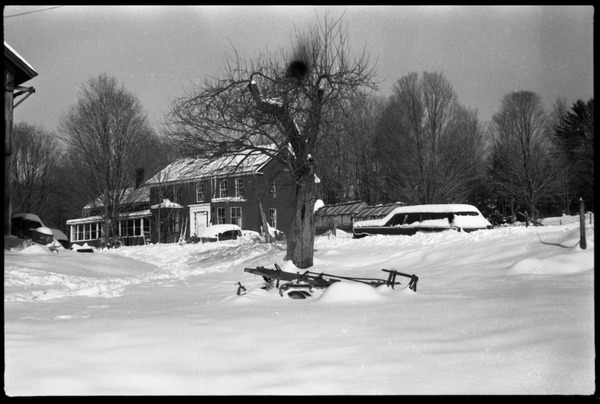 View looking up to the front of the house under heavy snow, Montague Farm commune, ca. 1974