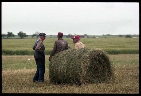 Talk of the morning: three Kansas farmers took some time off from loading