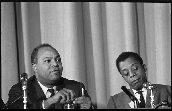 James Farmer (left) and James Baldwin as part of a panel at the Youth, Non-Violence, and Social Change             conference, Howard University, November 5, 1963
