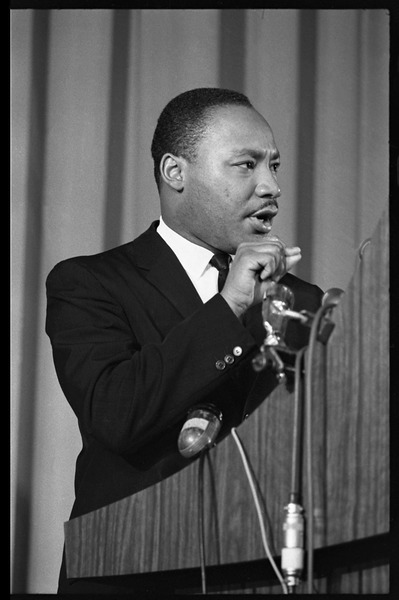 Martin Luther King, Jr., speaking from a podium, 1968