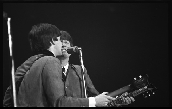 Paul McCartney and John Lennon performing with the Beatles at the Washington Coliseum, February 11, 1964