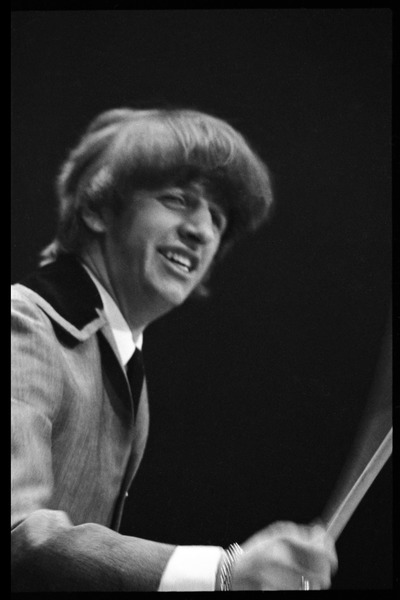 Ringo Starr on drums, in concert with the Beatles, Washington Coliseum, February 11, 1964