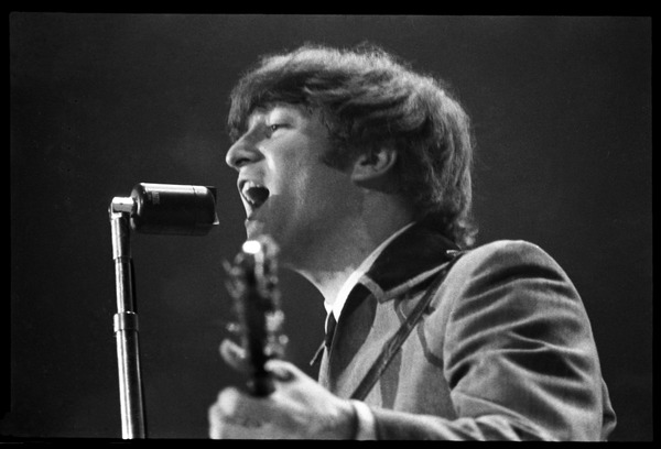 John Lennon at the microphone, in concert with the Beatles, Washington Coliseum, February 11, 1964