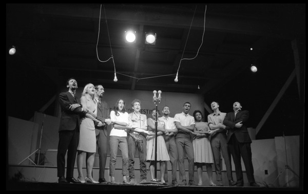 We Shall Overcome: performers on stage, Newport Folk Festival: Left to right: Peter Yarrow, Mary Travers, Paul Stookey, Joan Baez, Bob Dylan,             Bernice Reagon, Cordell Reagon, Charles Neblett, Rutha Harris, Pete Seeger, and Theodore             Bikel: , July 1963