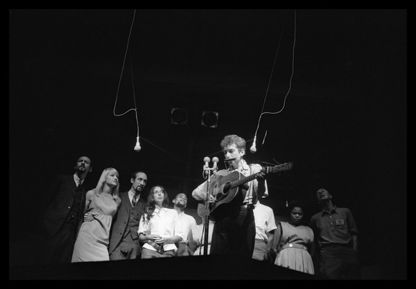 Bob Dylan leading performers on stage, Newport Folk Festival: Left to right: Peter Yarrow, Mary Travers, Paul Stookey, Joan Baez, Bob Dylan,             Bernice Reagon, Cordell Reagon, Charles Neblett, Rutha Harris, Pete Seeger: , July 1963