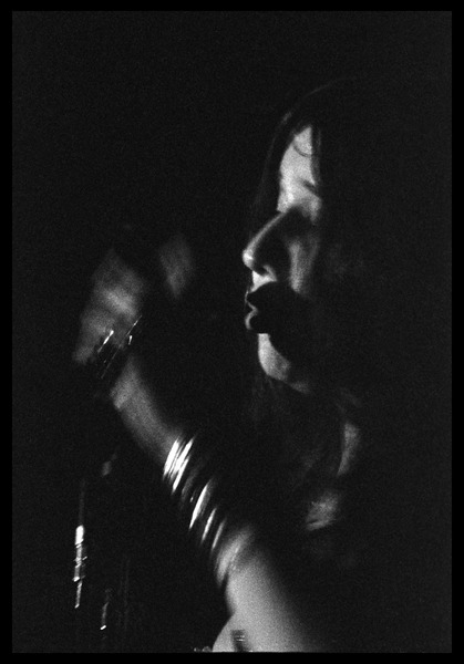 Janis Joplin performing at Woodstock: Close-up portrait at the microphone: , August 16, 1969