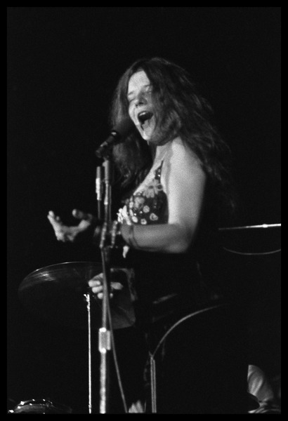 Janis Joplin performing at Woodstock: Half-length portrait at the microphone: , August 16, 1969