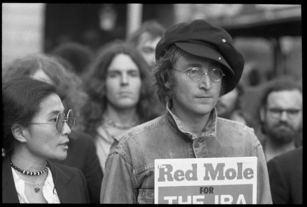 John Lennon holding up a copy of Red Mole (Marxist underground newspaper) and             Yoko Ono at a demonstration against the prosecution of Oz Magazine editors on charges of             obscenity, August 1971