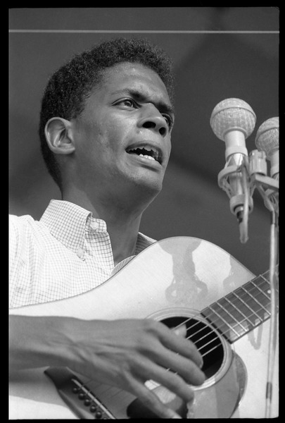 Jackie Washington on stage, playing guitar, Newport Folk Festival, July 28, 1963