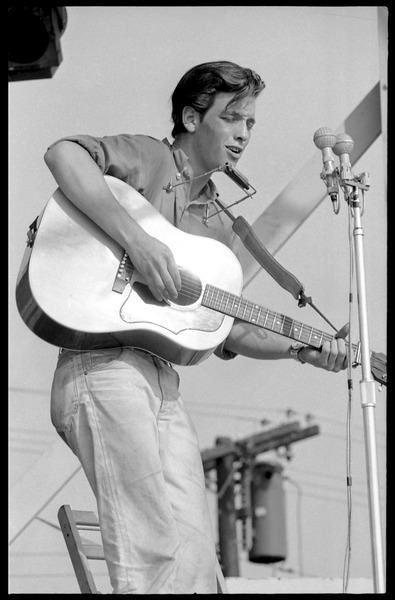 John Hammond (guitar and harmonica) performing on stage, Newport Folk Festival, July 28, 1963