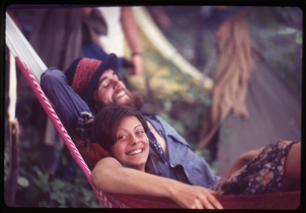 Couple lounging in a hammock, Woodstock Festival, August 17, 1969