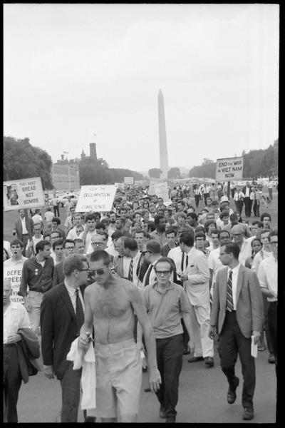 Marchers on the National Mall carrying anti-war signs, heading toward the U.S.             Capitol building (Washington Monument in the background), August 6, 1965