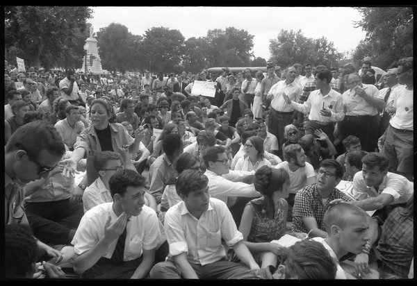Anti-Vietnam war protesters sitting down after Assembly of Unrepresented People             peace march, August 6, 1965