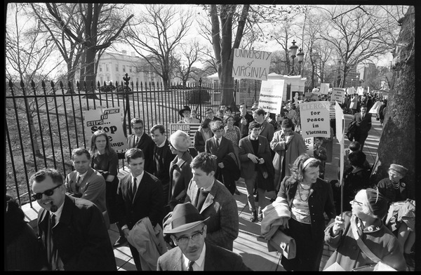 Protesters outside the White House marching against the war in Vietnam, carrying         signs reading 'Clergy for peace in Vietnam,' 'University of Virginia,' and more: Washington Vietnam March for Peace, November 27, 1965