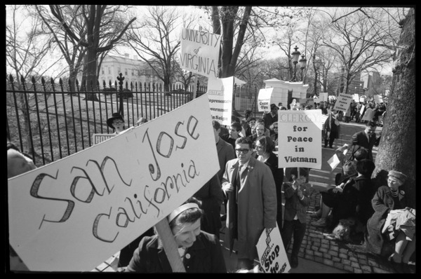 Protesters outside the White House marching against the war in Vietnam, carrying         signs reading 'Clergy for peace in Vietnam,' and nun carrying a sign: 'San Jose California': Washington Vietnam March for Peace, November 27, 1965