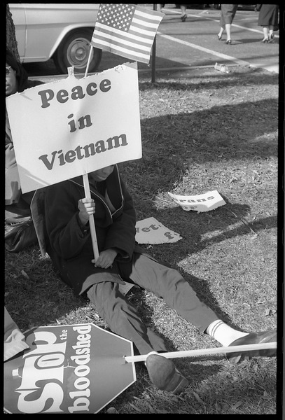 Young African American antiwar protester holding a sign reading 'Peace in Vietnam': Washington Vietnam March for Peace, November 27, 1965