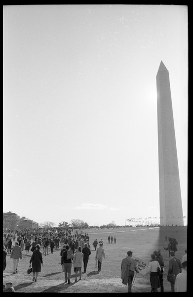 Protesters walking past the Washington Monument: Washington Vietnam March for Peace, November 27, 1965