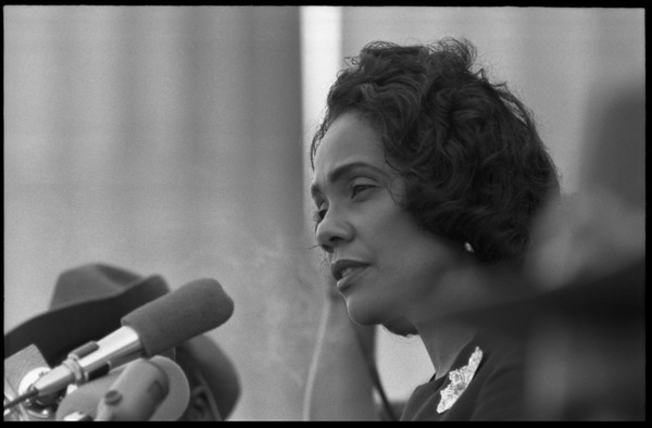 Coretta Scott King addressing the Solidarity Day crowd at the Poor People's             March on Washington, speaking against the War in Vietnam: Portrait in profile, at the microphones: , June 19, 1968