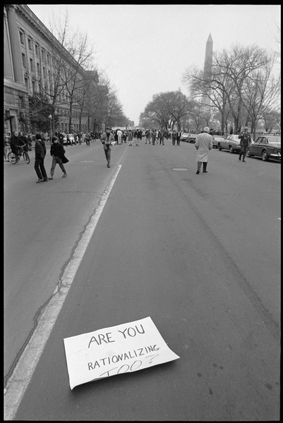 Anti-Vietnam War marchers in the streets of Washington during the             Counter-inaugural demonstrations, 1969: Sign fallen in the street read 'Are you rationalizing too?': , ca. January 19, 1968