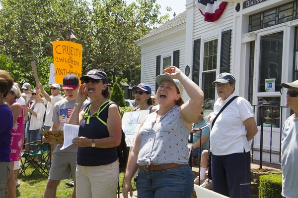 Pro-immigration protesters shouting outside the Chatham town offices building : taken at the 'Families Belong Together' protest against the Trump             administration's immigration policies, June 30, 2018