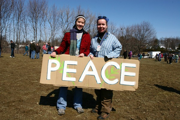 Two women holding a sign reading 'Peace': rally and march against the Iraq War, March 19, 2005