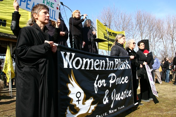 Protesters holding up a banner reading 'Women in Black for Peace and Justice': rally and march against the Iraq War, March 19, 2005