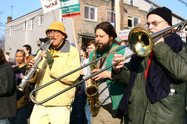 Brass band playing among anti-war marchers: rally and march against the Iraq War, March 19, 2005