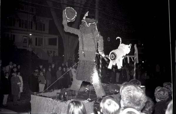 Homecoming Parade (versus the University of Rhode Island): Skew the Rams (Sigma Alpha Mu fraternity): float with 'Indian' shooting a ram         in the rear: , ca. October 20, 1967