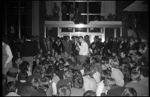 Sit-in protesting Dow Chemical Co. and the war in Vietnam, Student Union, UMass Amherst: Harvey Stone interviews students for WMUA radio: , ca. February 14, 1968
