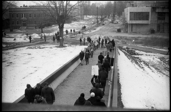 Demonstration against Dow Chemical Co. and the war in Vietnam outside Whitmore             Hall, UMass Amherst: Protesters lining the ramp to the entrance to Whitmore Hall, Herter Hall             (under construction) in background: , ca. February 15, 1968