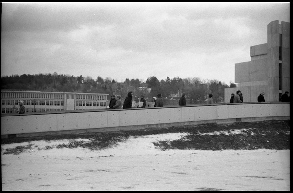 Demonstration against Dow Chemical Co. and the war in Vietnam outside Whitmore             Hall, UMass Amherst: Protesters lining the ramp to the entrance to Whitmore Hall, view from the             side looking west: , ca. February 15, 1968