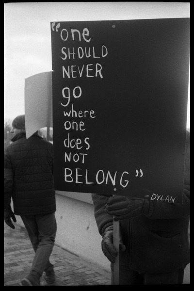Sign carried by protester against Dow Chemical Co. and the war in Vietnam outside Whitmore             Hall, UMass Amherst: 'One should never go where one does not belong -- Dylan': , ca. February 15, 1968