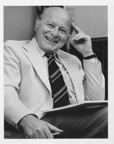 Henry Koffler sitting in his office, ca. 1980