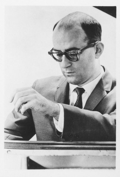 Howard M. Lebow sitting indoors, ca. 1965