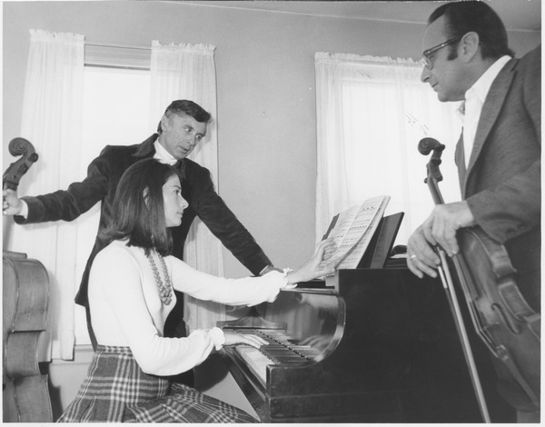 Julian and Estela Olevsky consult with an unidentifed man, September 12, 1968