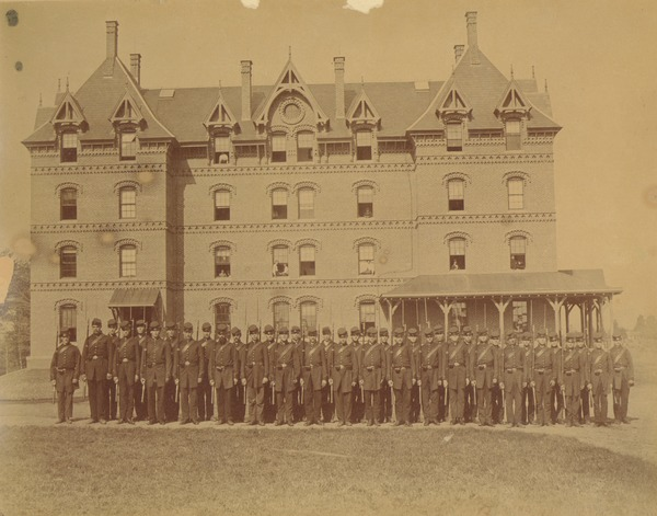 Class of 1871 members pose in uniform in front of North College, ca. 1871